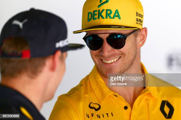 Nico Hulkenberg of Germany and Renault Sport F1 talks with Max Verstappen of Netherlands and Red Bull Racing during the Spanish Formula One Grand...