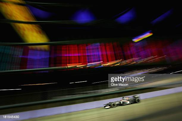 Nico Hulkenberg of Germany and Sauber F1 drives during the Singapore Formula One Grand Prix at Marina Bay Street Circuit on September 22 2013 in...