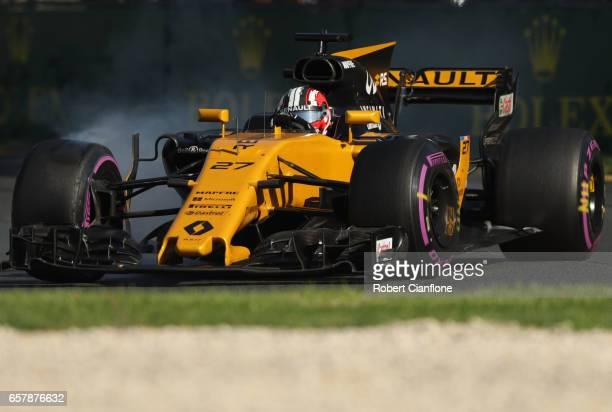 Nico Hulkenberg of Germany driving the Renault Sport Formula One Team Renault RS17 locks a wheel under braking on track during the Australian Formula...