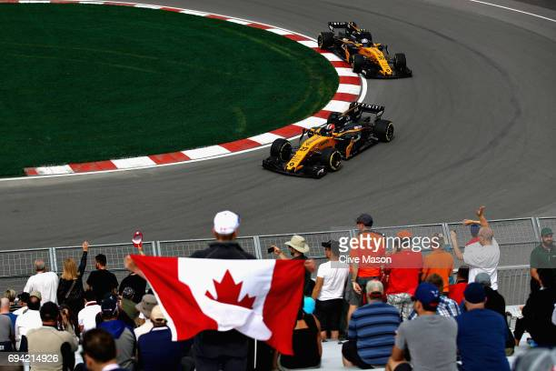 Nico Hulkenberg of Germany driving the Renault Sport Formula One Team Renault RS17 leads Jolyon Palmer of Great Britain driving the Renault Sport...