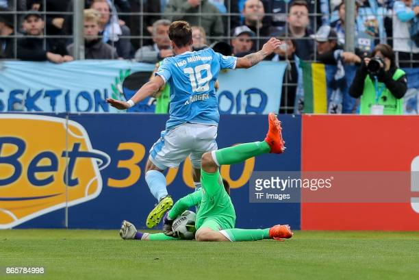 Nico Karger of 1860 Muenchen and goalkeeper Christian Fruechtl of Bayern Muenchen battle for the ball during the match between TSV 1860 Muenchen and...