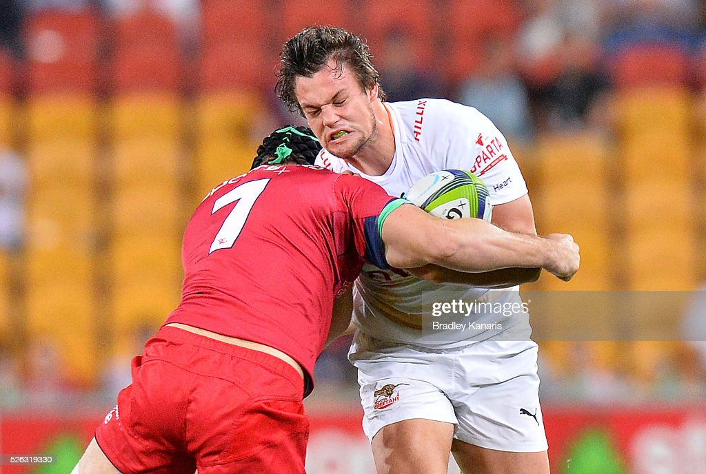 Nico Lee of the Cheetahs takes on the defence during the round 10 Super Rugby match between the Reds and the Cheetahs at Suncorp Stadium on April 30, 2016 in Brisbane, Australia.