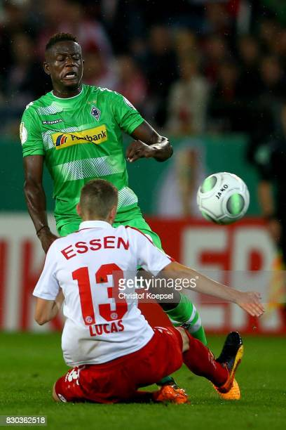 Nico Lucas of Essen challenges Denis Zakaria of Mnchengladbach during the DFB Cup first round match between RotWeiss Essen and Borussia...