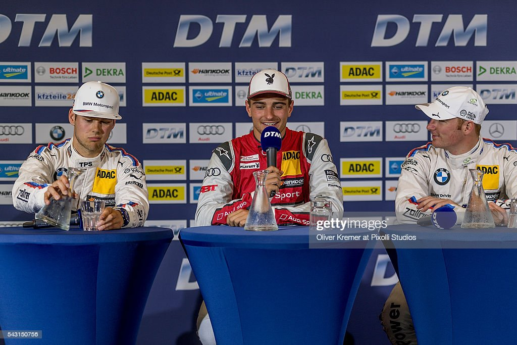 Nico Mueller (CHE) of Audi Sport Team Abt Sportsline winner of the German Touring Car Championship race together with his opponents Tom Blomquist (GBR) of BWM Team RBM and Maxime Martin (BEL) of BWM Team RBM during the press conference at the Norisring during Day 2 of the 74. International ADAC Norisring Speedweekend on June 26, 2016 in Nuremberg, Germany.