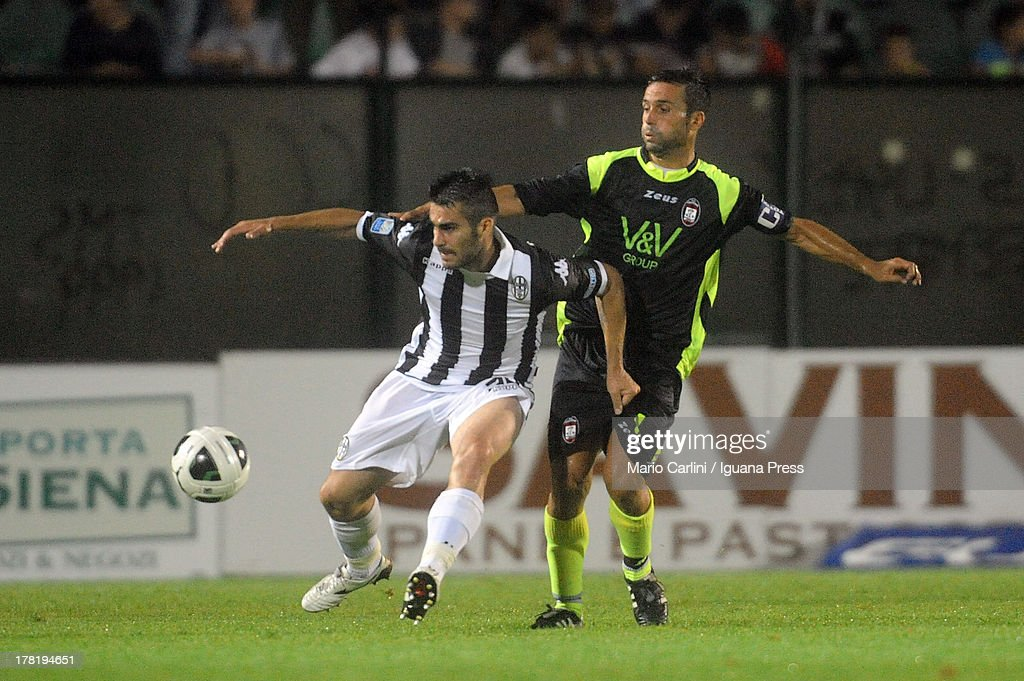 Nico Pulzetti # 30 of AC Siena ( L ) competes the ball with Antonio Galardo # 4 of FC Crotone ( R ) during the Serie B match between AC Siena and FC Crotone at Stadio Artemio Franchi on August 24, 2013 in Siena, Italy.