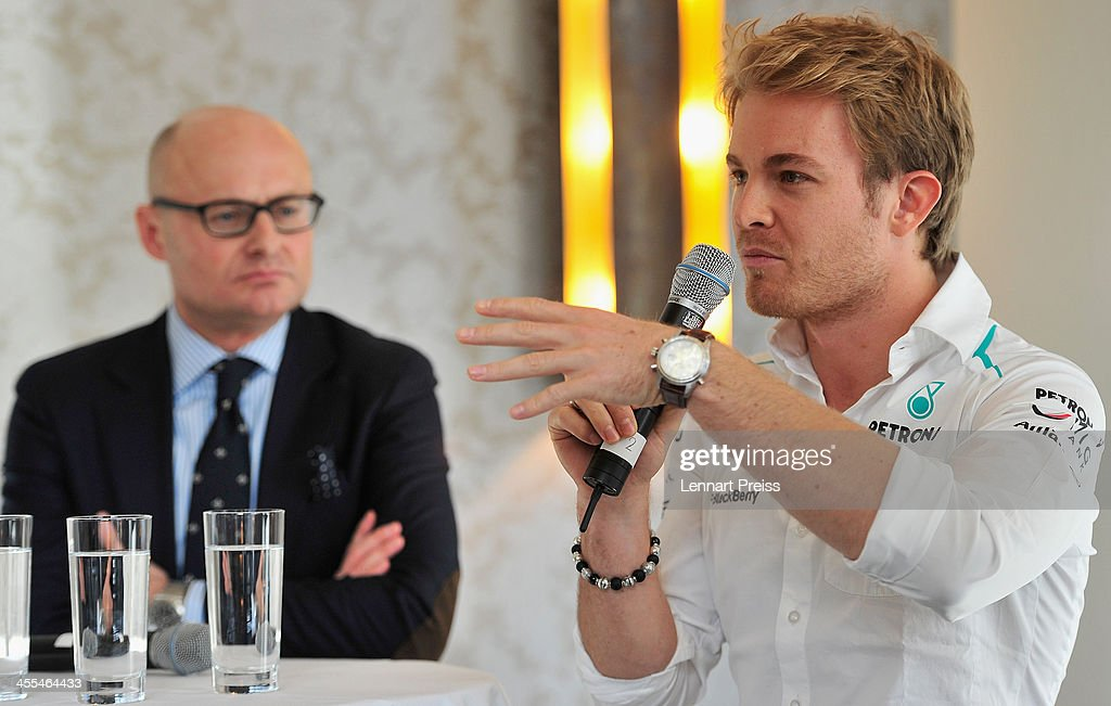 <a gi-track='captionPersonalityLinkClicked' href=/galleries/search?phrase=Nico+Rosberg&family=editorial&specificpeople=800808 ng-click='$event.stopPropagation()'>Nico Rosberg</a> (R) and George Kern, CEO of swiss watch manufacturer IWC speak during a press talk following a watchmaking class by swiss watch manufacturer IWC at The Charles Hotel on December 12, 2013 in Munich, Germany.