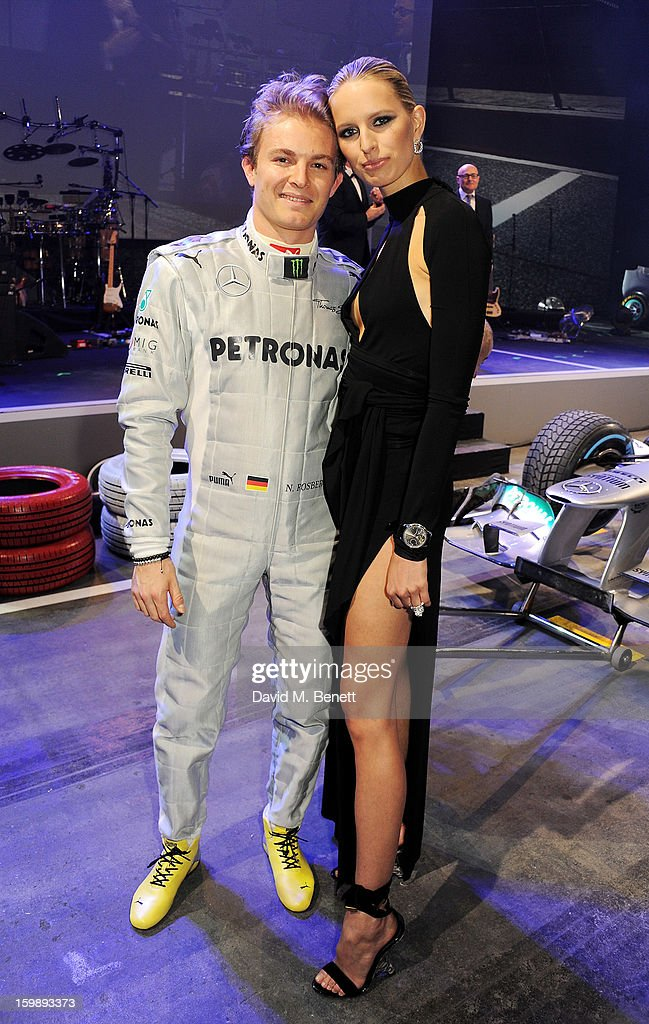 Nico Rosberg (L) and Karolina Kurkova attend the IWC Schaffhausen Race Night event during the Salon International de la Haute Horlogerie (SIHH) 2013 at Palexpo on January 22, 2013 in Geneva, Switzerland.