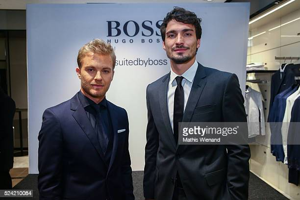 Nico Rosberg and Mats Hummels attend the Hugo Boss Store Event on April 25 2016 in Duesseldorf Germany