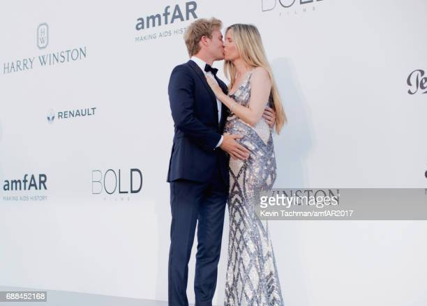 Nico Rosberg and Vivian Sibold arrive at the amfAR Gala Cannes 2017 at Hotel du CapEdenRoc on May 25 2017 in Cap d'Antibes France