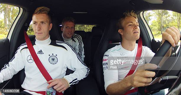 Nico Rosberg drives the new Mercedes AClass with Marco Reus and Andre Schuerrle on a street on May 23 2012 in Torrettes Sur Loup France Director of...