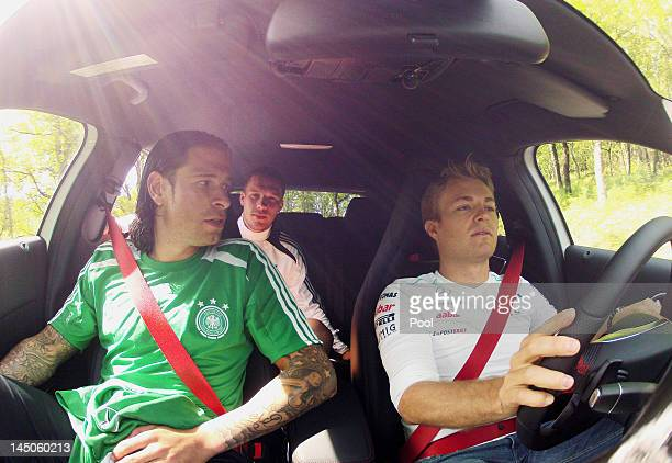 Nico Rosberg drives the new Mercedes AClass with Tim Wiese and Lukas Podolski on a street on May 23 2012 in Torrettes Sur Loup France Director of...