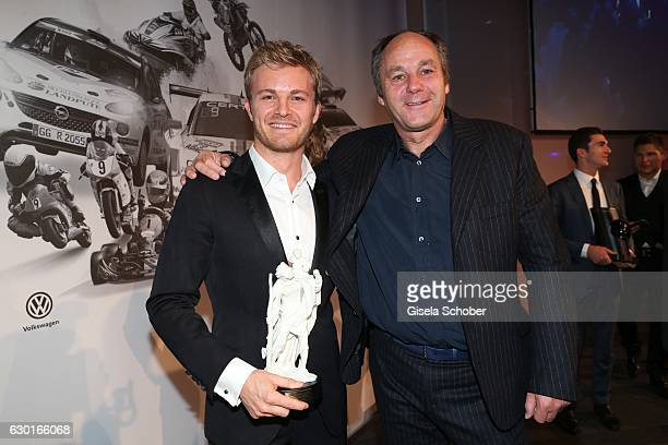 Nico Rosberg Formula One F1 driver and World Champion 2016 with 'Christophorus' award and Gerhard Berger during the ADAC sportgala 'Die Nacht der...