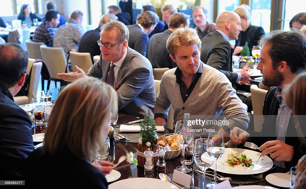 <a gi-track='captionPersonalityLinkClicked' href=/galleries/search?phrase=Nico+Rosberg&family=editorial&specificpeople=800808 ng-click='$event.stopPropagation()'>Nico Rosberg</a> (C) is pictured after a watchmaking class by swiss watch manufacturer IWC at The Charles Hotel on December 12, 2013 in Munich, Germany.