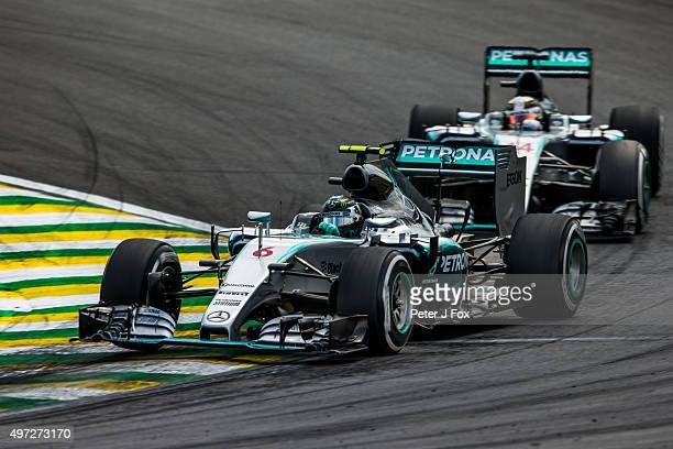 Nico Rosberg of Germany and Lewis Hamilton of Great Britain both of Mercedes during the Formula One Grand Prix of Brazil at Autodromo Jose Carlos...
