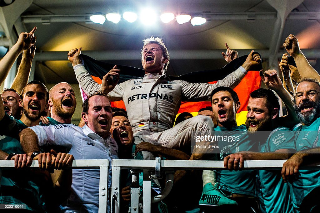 Nico Rosberg of Germany and Mercedes celebrates with his team after becoming the 2016 F1 World Drivers Champion during the Abu Dhabi Formula One Grand Prix at Yas Marina Circuit on November 27, 2016 in Abu Dhabi, United Arab Emirates.