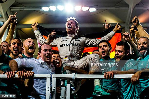 Nico Rosberg of Germany and Mercedes celebrates with his team after becoming the 2016 F1 World Drivers Champion during the Abu Dhabi Formula One...