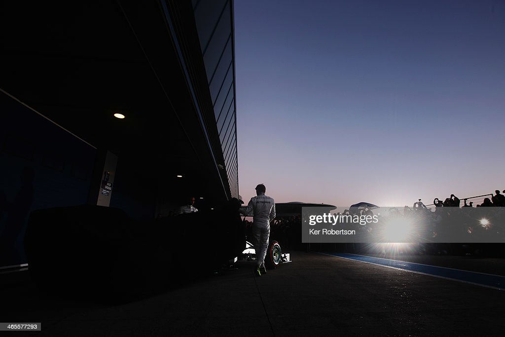 <a gi-track='captionPersonalityLinkClicked' href=/galleries/search?phrase=Nico+Rosberg&family=editorial&specificpeople=800808 ng-click='$event.stopPropagation()'>Nico Rosberg</a> (R) of Germany and Mercedes GP and <a gi-track='captionPersonalityLinkClicked' href=/galleries/search?phrase=Lewis+Hamilton+-+Racecar+Driver&family=editorial&specificpeople=586983 ng-click='$event.stopPropagation()'>Lewis Hamilton</a> (L) of Great Britain and Mercedes GP unveil the new Mercedes W05 during day one of Formula One Winter Testing at the Circuito de Jerez on January 28, 2014 in Jerez de la Frontera, Spain.