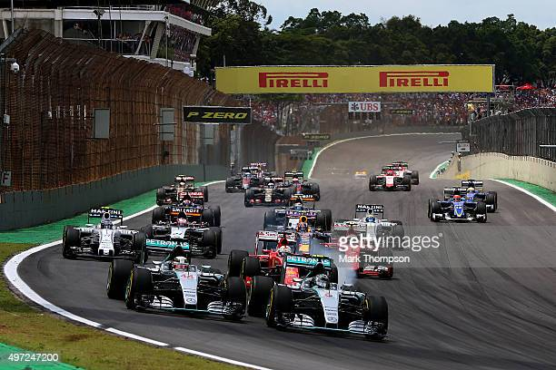 Nico Rosberg of Germany and Mercedes GP and Lewis Hamilton of Great Britain and Mercedes GP race into the first corner followed by the rest of the...