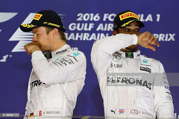 Nico Rosberg of Germany and Mercedes GP and Lewis Hamilton of Great Britain and Mercedes GP on the podium during the Bahrain Formula One Grand Prix...