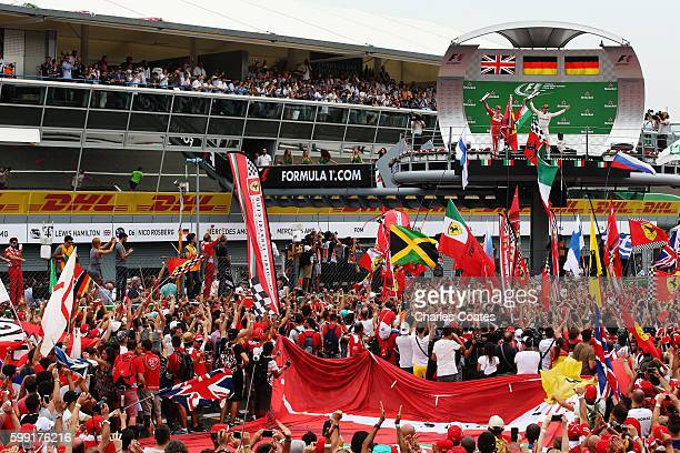 Nico Rosberg of Germany and Mercedes GP and Sebastian Vettel of Germany and Ferrari celebrate on the podium during the Formula One Grand Prix of...