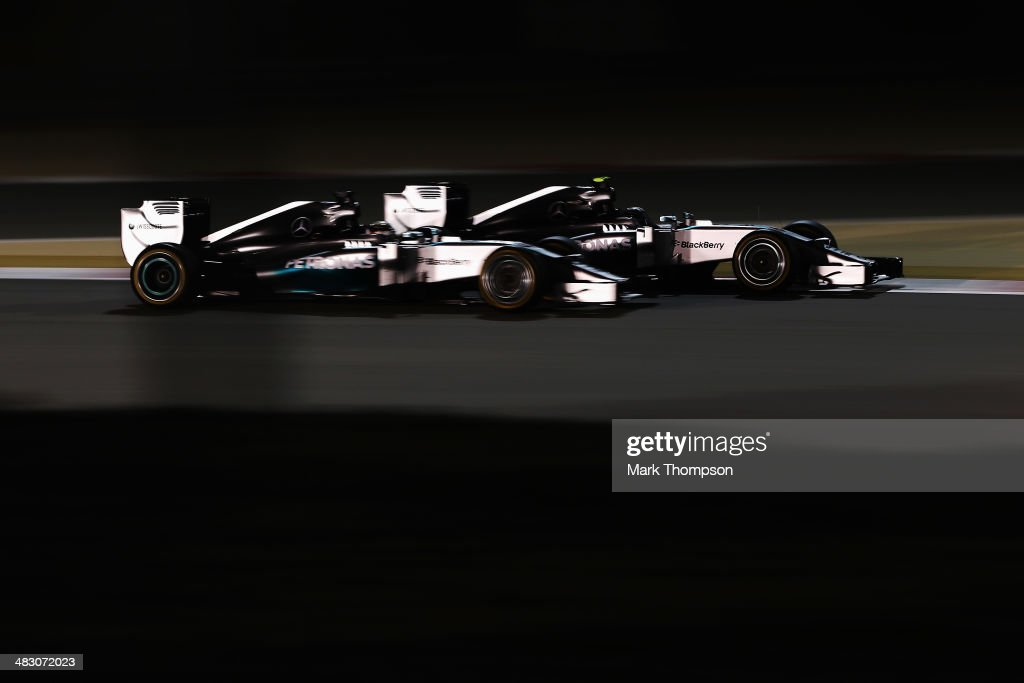 Nico Rosberg (R) of Germany and Mercedes GP and team mate Lewis Hamilton (L) of Great Britain and Mercedes GP battle for the lead during Bahrain Formula One Grand Prix at the Bahrain International Circuit on April 6, 2014 in Sakhir, Bahrain.