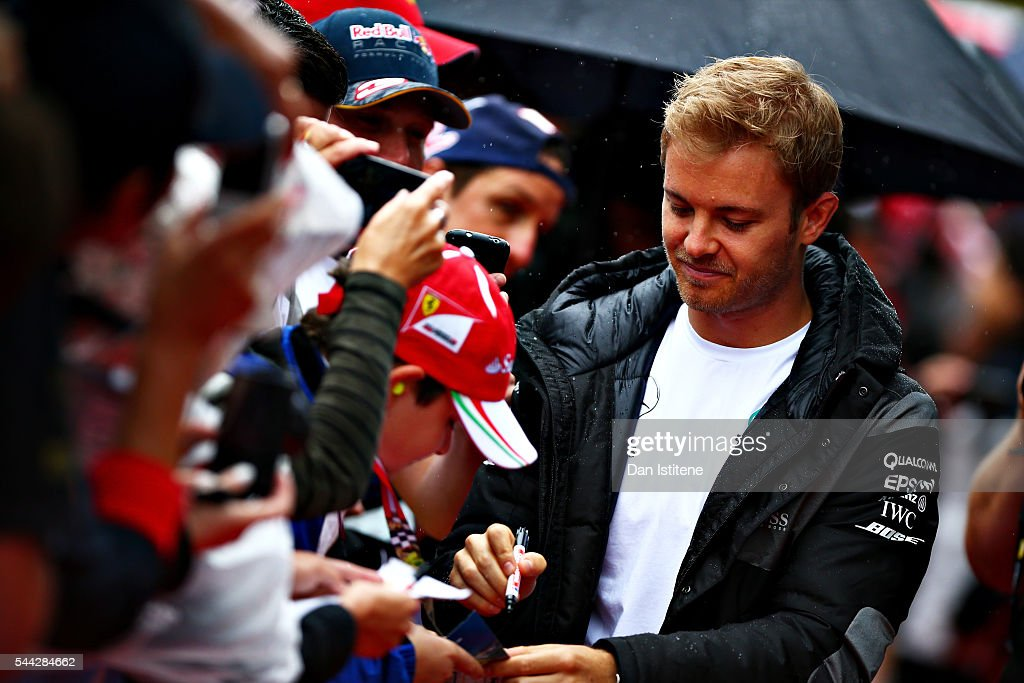 Nico Rosberg of Germany and Mercedes GP arrives at the circuit and signs autographs for fans before the Formula One Grand Prix of Austria at Red Bull...