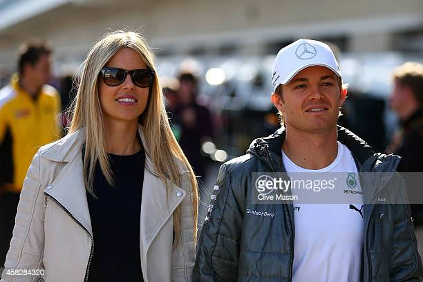 Nico Rosberg of Germany and Mercedes GP arrives in the paddock with his wife Vivian Sibold before the United States Formula One Grand Prix at Circuit...