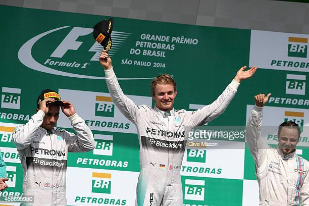 Nico Rosberg of Germany and Mercedes GP celbrates next to Lewis Hamilton of Great Britain and Mercedes GP and Felipe Massa of Brazil and Williams...