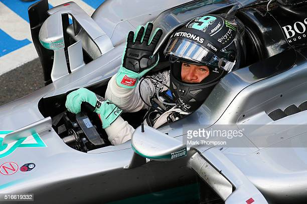 Nico Rosberg of Germany and Mercedes GP celebrates as he drives in to Parc Ferme after winning the Australian Formula One Grand Prix at Albert Park...