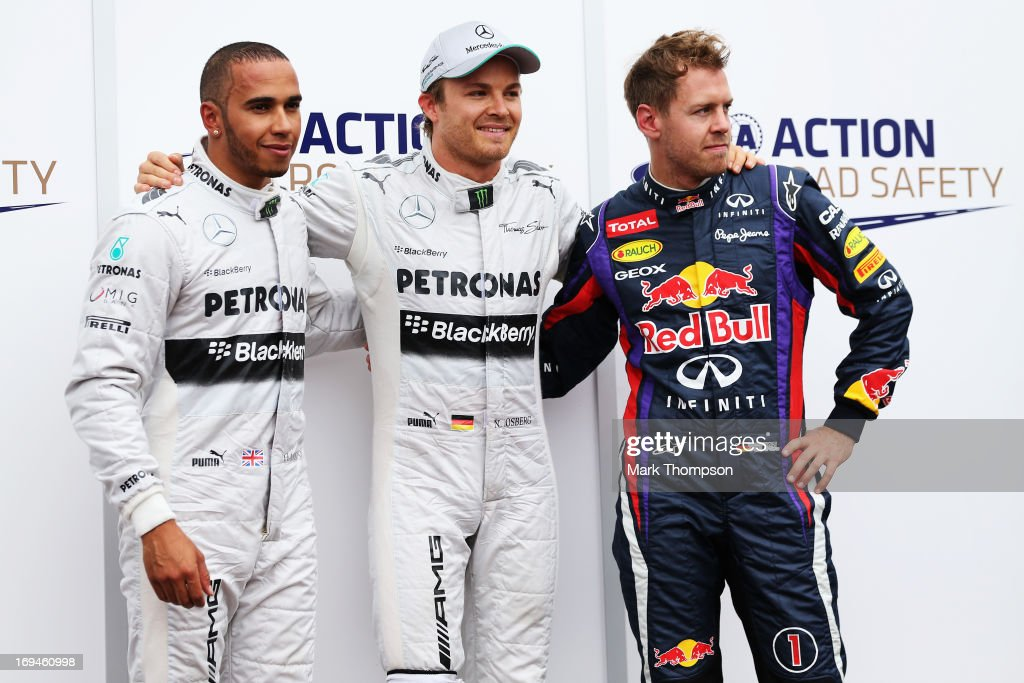 Nico Rosberg (C) of Germany and Mercedes GP celebrates finishing first alongside second placed Lewis Hamilton (L) of Great Britain and Mercedes GP and third placed Sebastian Vettel (R) of Germany and Infiniti Red Bull Racing following qualifying for the Monaco Formula One Grand Prix at the Circuit de Monaco on May 25, 2013 in Monte-Carlo, Monaco.