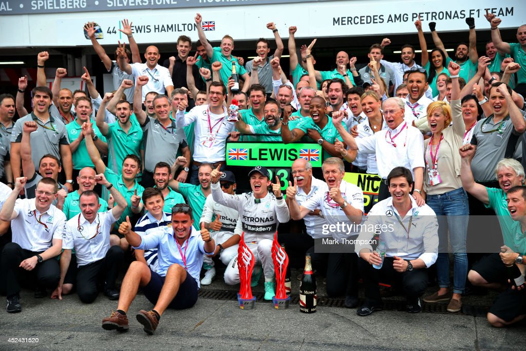 <a gi-track='captionPersonalityLinkClicked' href=/galleries/search?phrase=Nico+Rosberg&family=editorial&specificpeople=800808 ng-click='$event.stopPropagation()'>Nico Rosberg</a> of Germany and Mercedes GP celebrates his victory with the team including Mercedes GP Executive Director <a gi-track='captionPersonalityLinkClicked' href=/galleries/search?phrase=Toto+Wolff&family=editorial&specificpeople=3576178 ng-click='$event.stopPropagation()'>Toto Wolff</a>, CEO of Mercedes <a gi-track='captionPersonalityLinkClicked' href=/galleries/search?phrase=Dieter+Zetsche&family=editorial&specificpeople=241297 ng-click='$event.stopPropagation()'>Dieter Zetsche</a> and <a gi-track='captionPersonalityLinkClicked' href=/galleries/search?phrase=Lewis+Hamilton+-+Racecar+Driver&family=editorial&specificpeople=586983 ng-click='$event.stopPropagation()'>Lewis Hamilton</a> of Great Britain and Mercedes GP after the German Grand Prix by at Hockenheimring on July 20, 2014 in Hockenheim, Germany.