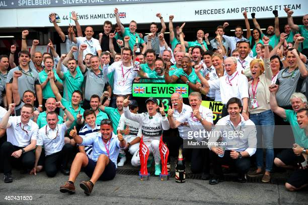 Nico Rosberg of Germany and Mercedes GP celebrates his victory with the team including Mercedes GP Executive Director Toto Wolff CEO of Mercedes...