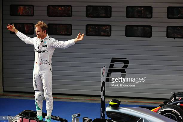 Nico Rosberg of Germany and Mercedes GP celebrates his win in parc ferme during the Formula One Grand Prix of China at Shanghai International Circuit...