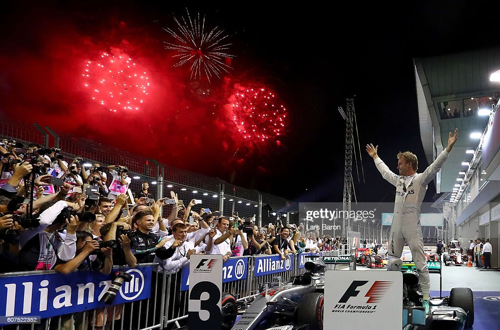 Nico Rosberg of Germany and Mercedes GP celebrates his win in parc ferme during the Formula One Grand Prix of Singapore at Marina Bay Street Circuit on September 18, 2016 in Singapore.
