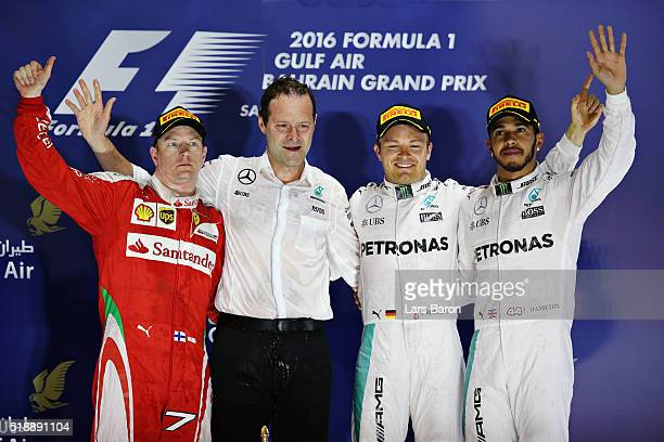 Nico Rosberg of Germany and Mercedes GP celebrates his win on the podium with Lewis Hamilton of Great Britain and Mercedes GP Kimi Raikkonen of...