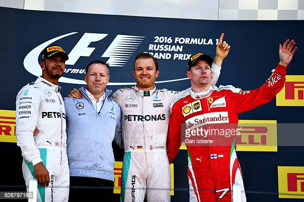 Nico Rosberg of Germany and Mercedes GP celebrates his win on the podium with Lewis Hamilton of Great Britain and Mercedes GP and Kimi Raikkonen of...