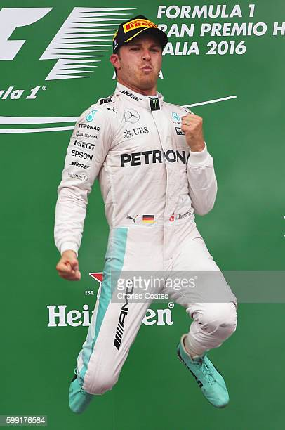 Nico Rosberg of Germany and Mercedes GP celebrates his win on the podium during the Formula One Grand Prix of Italy at Autodromo di Monza on...