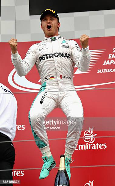 Nico Rosberg of Germany and Mercedes GP celebrates his win on the podium during the Formula One Grand Prix of Japan at Suzuka Circuit on October 9...