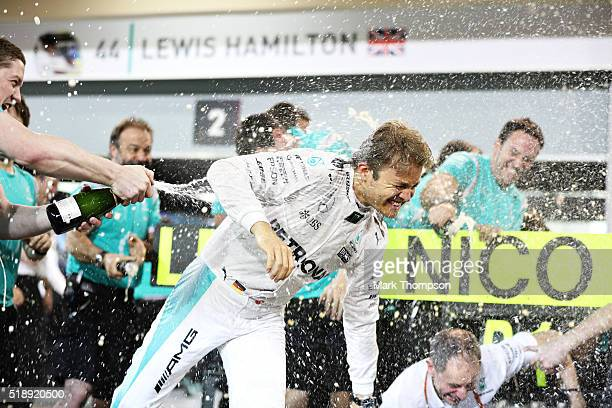 Nico Rosberg of Germany and Mercedes GP celebrates his win with his team during the Bahrain Formula One Grand Prix at Bahrain International Circuit...