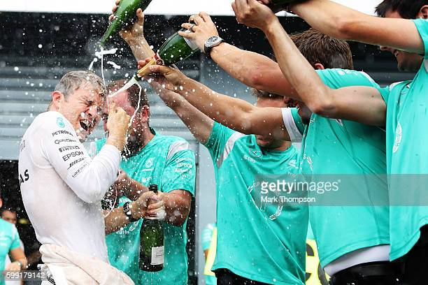 Nico Rosberg of Germany and Mercedes GP celebrates his win with his team during the Formula One Grand Prix of Italy at Autodromo di Monza on...
