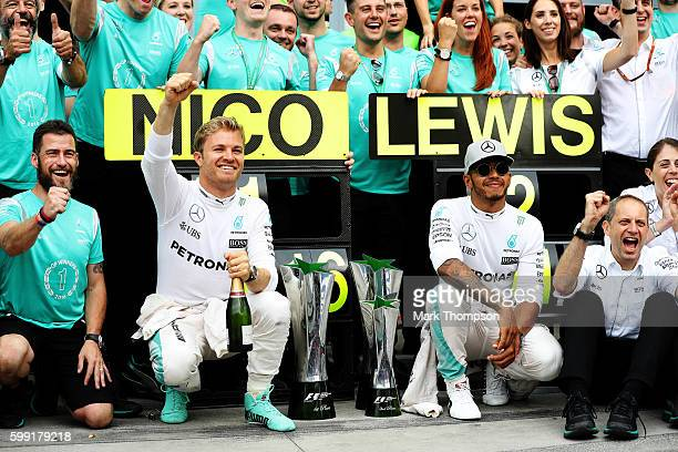 Nico Rosberg of Germany and Mercedes GP celebrates his win with his team and Lewis Hamilton of Great Britain and Mercedes GP during the Formula One...