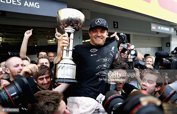Nico Rosberg of Germany and Mercedes GP celebrates his win with his team during the Formula One Grand Prix of Japan at Suzuka Circuit on October 9...