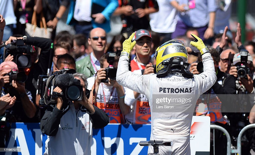 Nico Rosberg of Germany and Mercedes GP celebrates in parc ferme after winning the British Formula One Grand Prix at Silverstone Circuit on June 30, 2013 in Northampton, England.