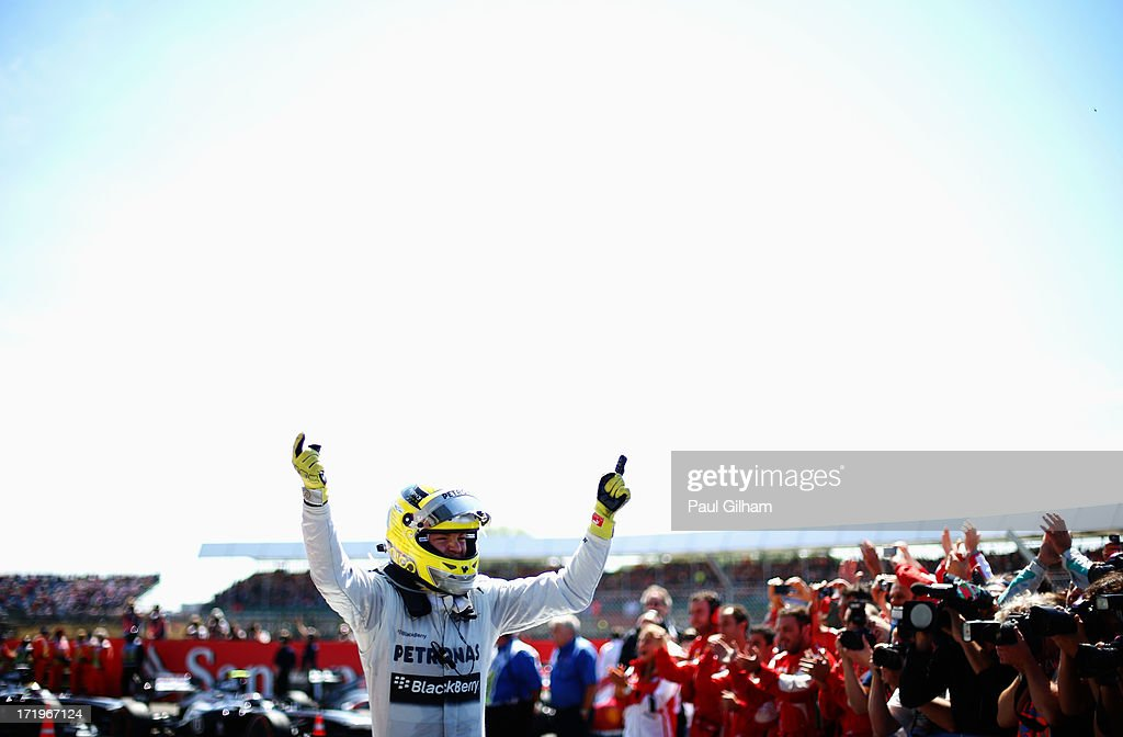 <a gi-track='captionPersonalityLinkClicked' href=/galleries/search?phrase=Nico+Rosberg&family=editorial&specificpeople=800808 ng-click='$event.stopPropagation()'>Nico Rosberg</a> of Germany and Mercedes GP celebrates in parc ferme after winning the British Formula One Grand Prix at Silverstone Circuit on June 30, 2013 in Northampton, England.