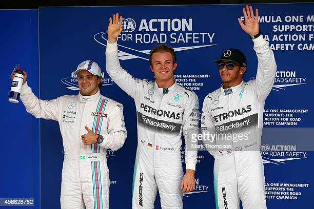 Nico Rosberg of Germany and Mercedes GP celebrates next to Lewis Hamilton of Great Britain and Mercedes GP and Felipe Massa of Brazil and Williams...