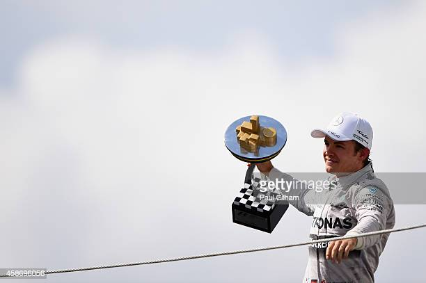 Nico Rosberg of Germany and Mercedes GP celebrates on the podium following his victory in the Brazilian Formula One Grand Prix at Autodromo Jose...