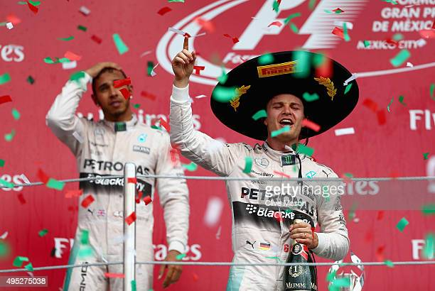 Nico Rosberg of Germany and Mercedes GP celebrates on the podium next to Lewis Hamilton of Great Britain and Mercedes GP after winning the Formula...