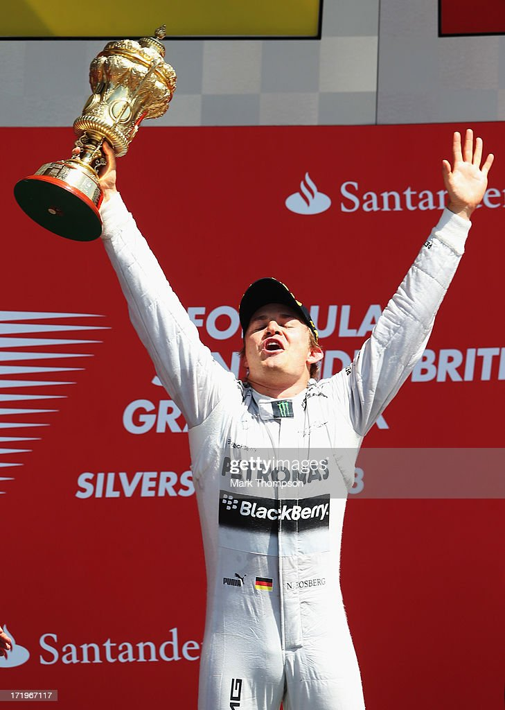 Nico Rosberg of Germany and Mercedes GP celebrates on the podium after winning the British Formula One Grand Prix at Silverstone Circuit on June 30, 2013 in Northampton, England.