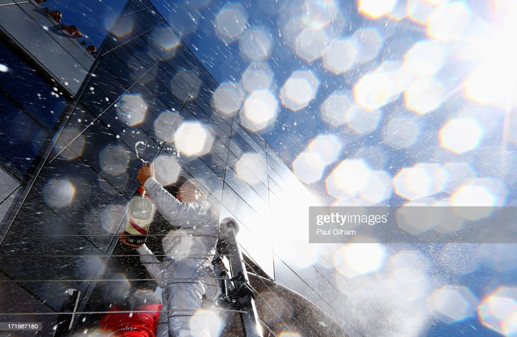 <a gi-track='captionPersonalityLinkClicked' href=/galleries/search?phrase=Nico+Rosberg&family=editorial&specificpeople=800808 ng-click='$event.stopPropagation()'>Nico Rosberg</a> of Germany and Mercedes GP celebrates on the podium after winning the British Formula One Grand Prix at Silverstone Circuit on June 30, 2013 in Northampton, England.