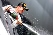 Nico Rosberg of Germany and Mercedes GP celebrates on the podium after winning the Formula One Grand Prix of Austria at Red Bull Ring on June 21 2015...